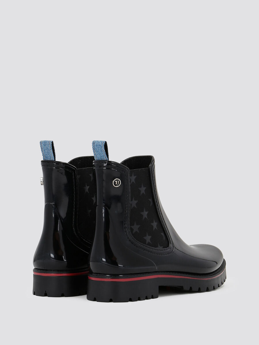 Rubber ankle boots with two tone sole and band