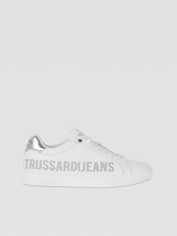 Sneakers with micro-perforated logo