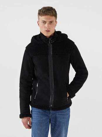 Blouson a capuche en mouton retourne synthetique