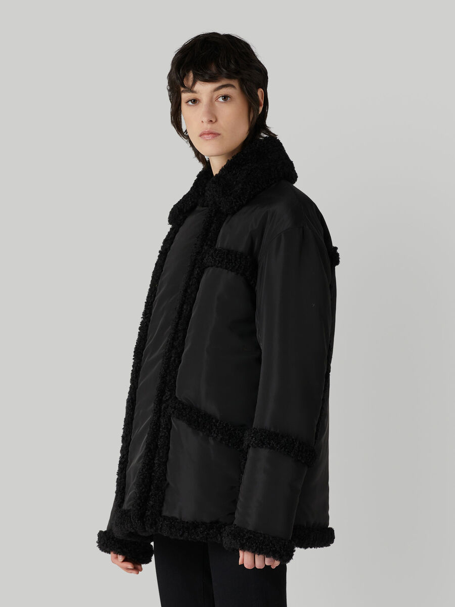 Reversible nylon and faux fur jacket