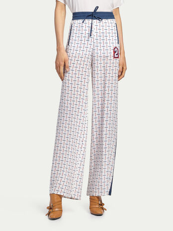 Palazzo trousers with criss crossing stripes