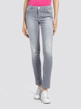 Jeans stretch delavati con strappi