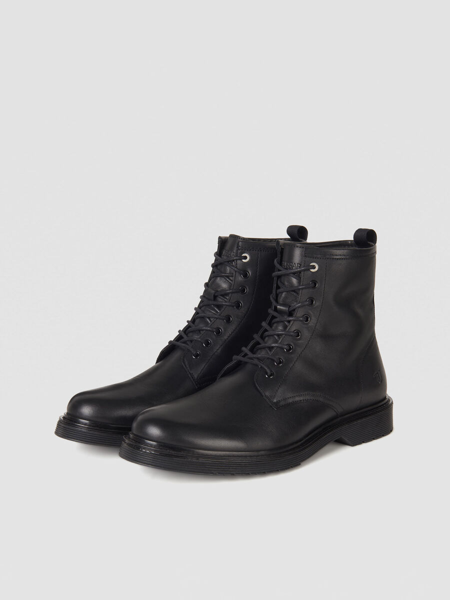 Leather combat boots with branded tape