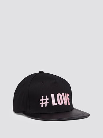 Baseball cap with glittery lettering