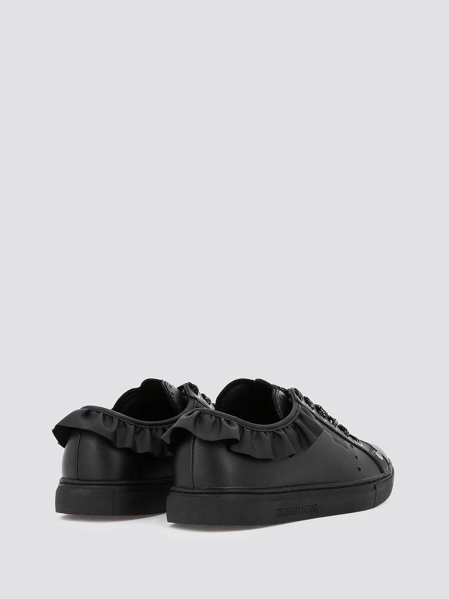 Sneakers in pelle laminata con volant