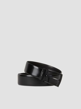 Leather belt with branded buckle
