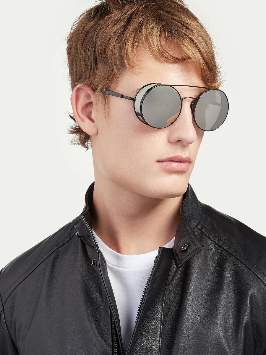 Sunglasses with semi transparent spoiler