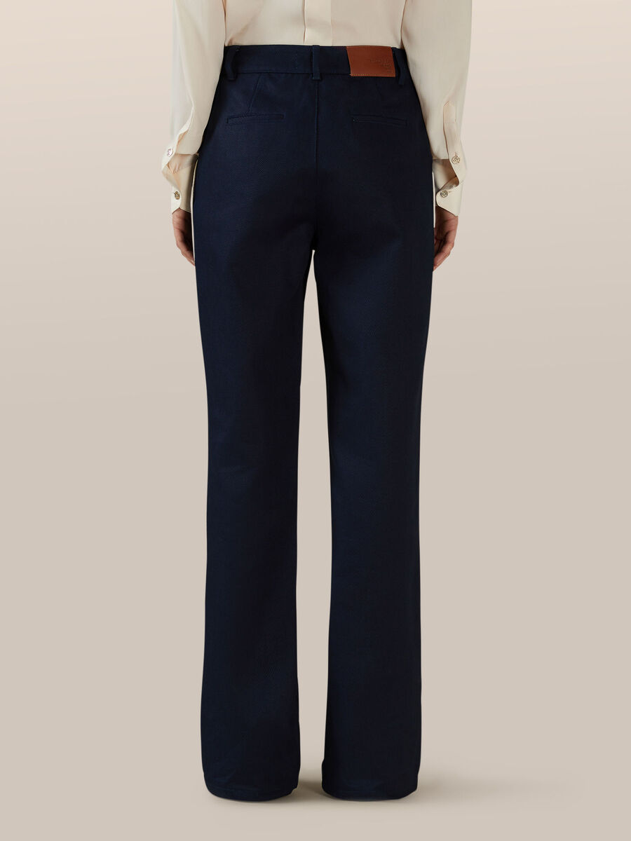 Wide cotton trousers with button details