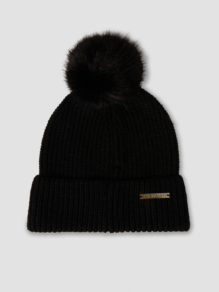Knit hat with pom pom and branded tag