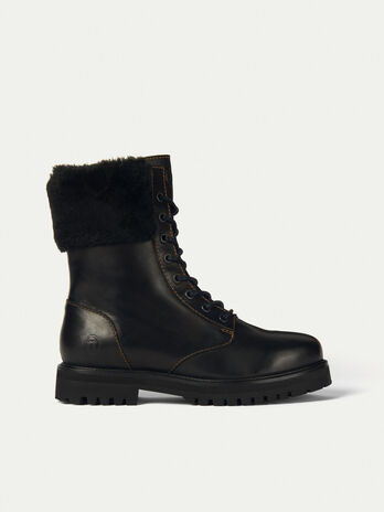Leather combat boots with faux fur detailing