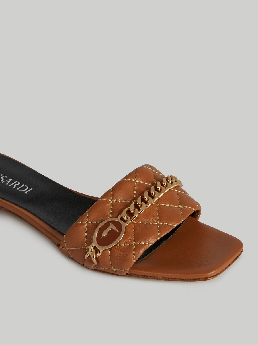 Flat quilted leather sandals