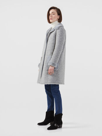 Reversible coat in knit fabric and faux fur