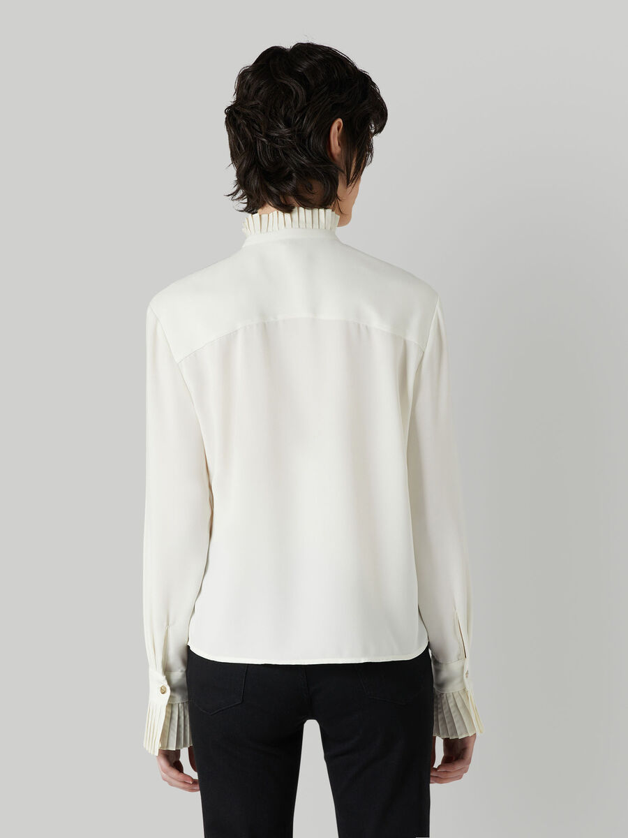 Shirt with pleated details