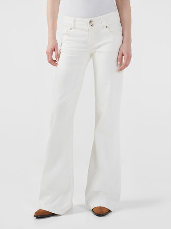 Feminine bell bottom trousers in stretch bull