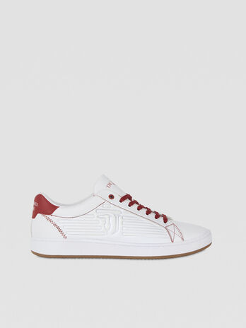 Sneaker in similpelle con logo embossed