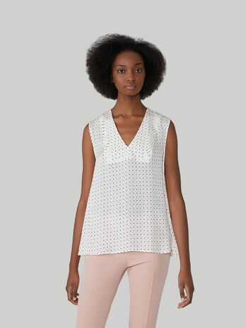 Sleeveless viscose blouse with polka-dot design