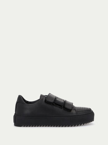 Sneakers in pelle con strappi