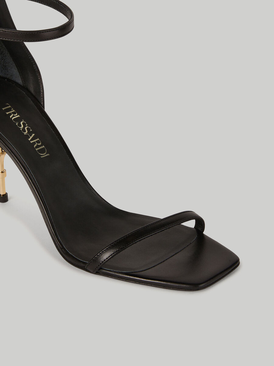 Leather sandals with dagger heel