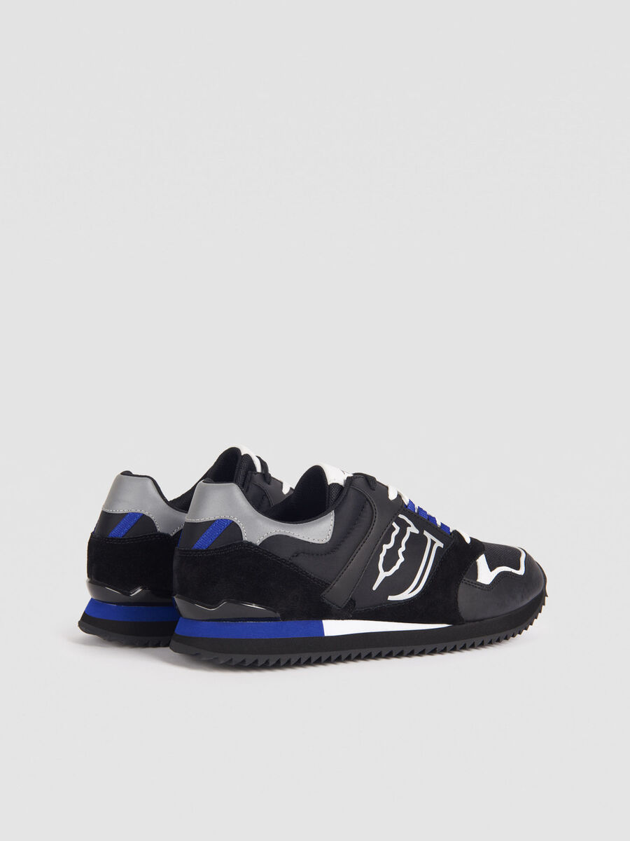 Sneaker running in pelle e tessuto tecnico con lacci