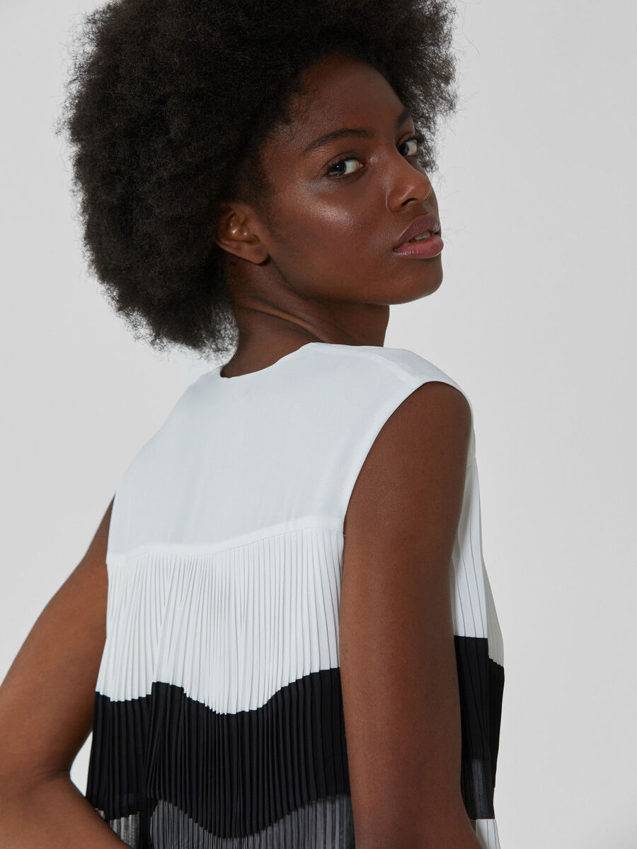 Pleated blouse with geometric design