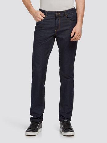 Jeans stonewashed tinta unita con cuciture