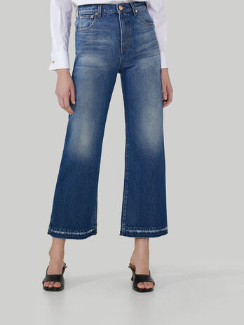 Wide-leg distressed denim jeans