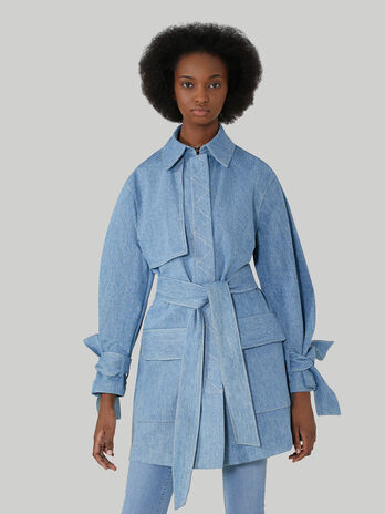 Light denim trench coat with tied cuffs