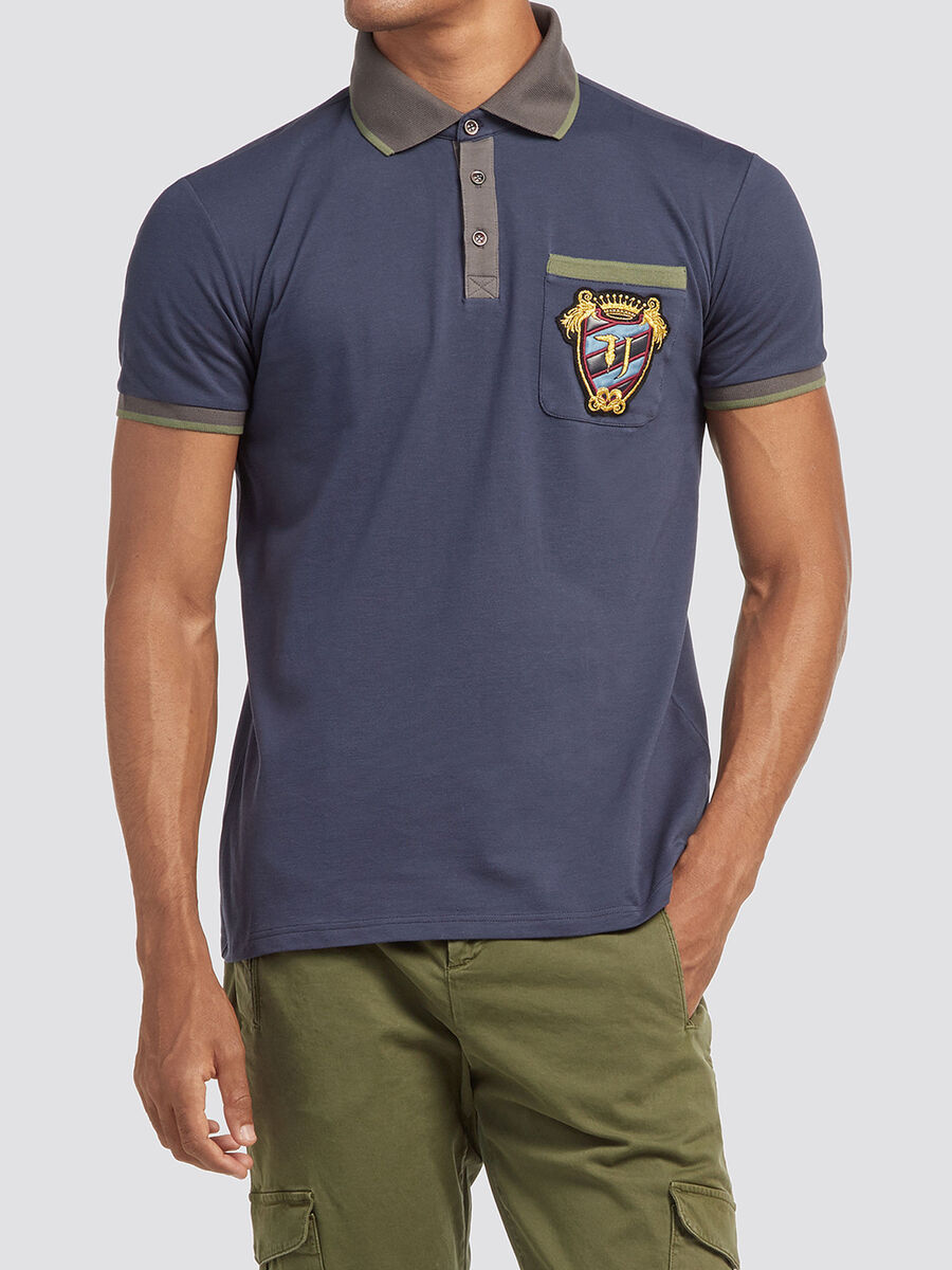 Polo shirt with striped trims and patch