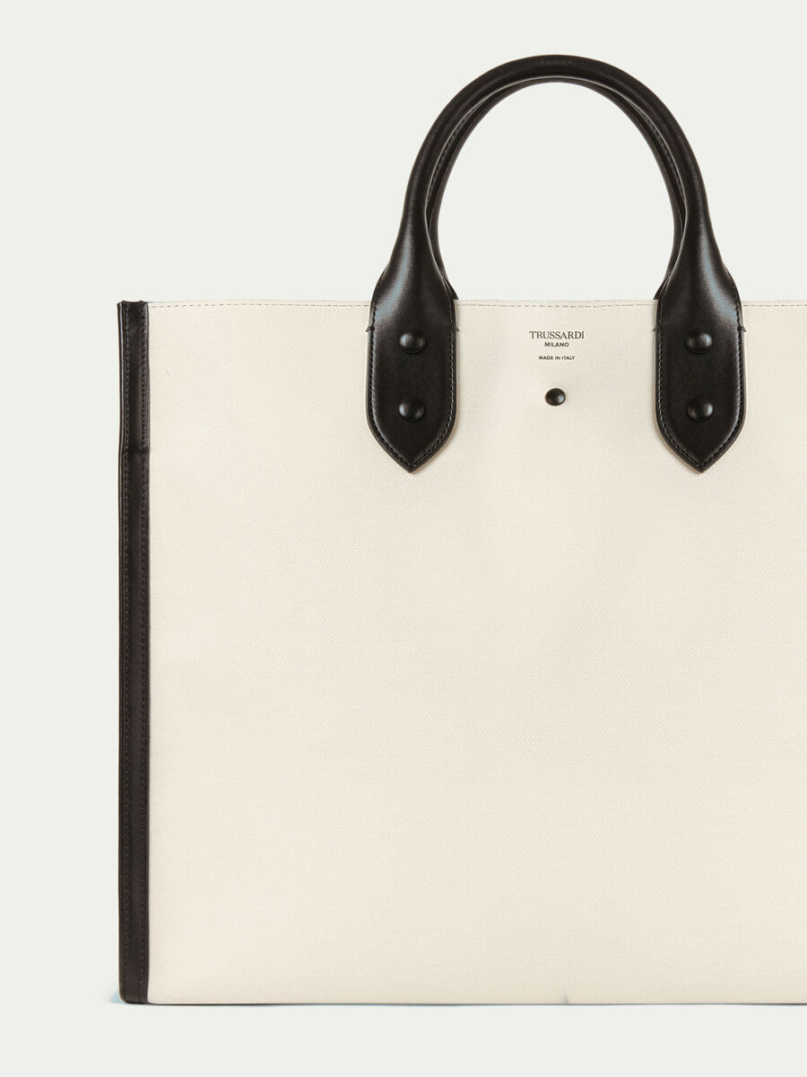 Clean dryllim textile shopping bag in leather with logo