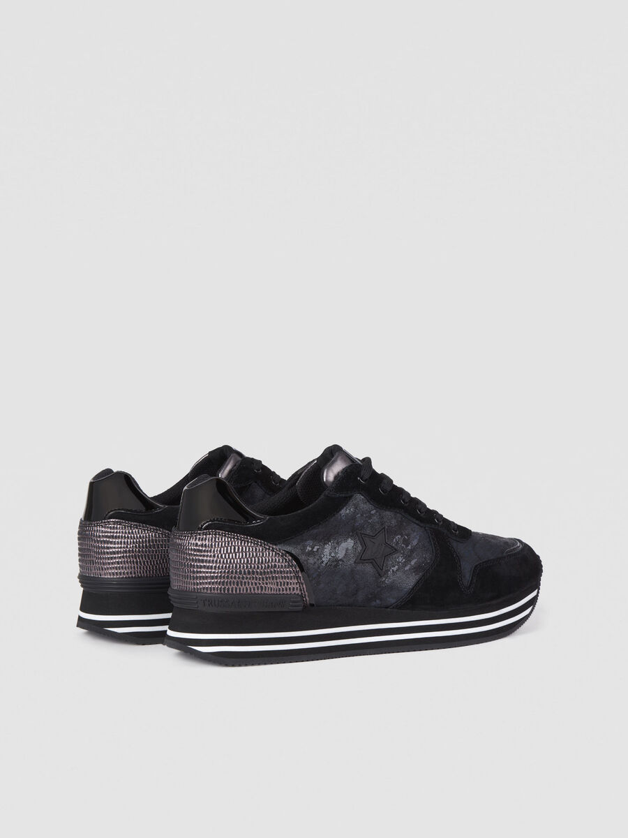 Faux leather sneakers with platform and star logo