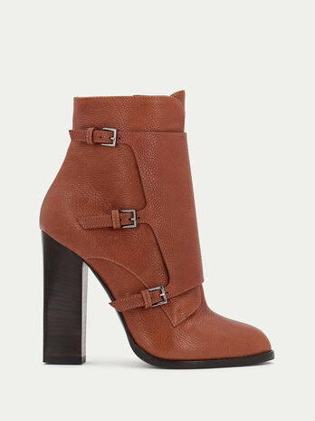 Leather ankle boots with a high heel and buckles