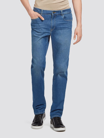 Distressed effect stretch jeans with whiskering