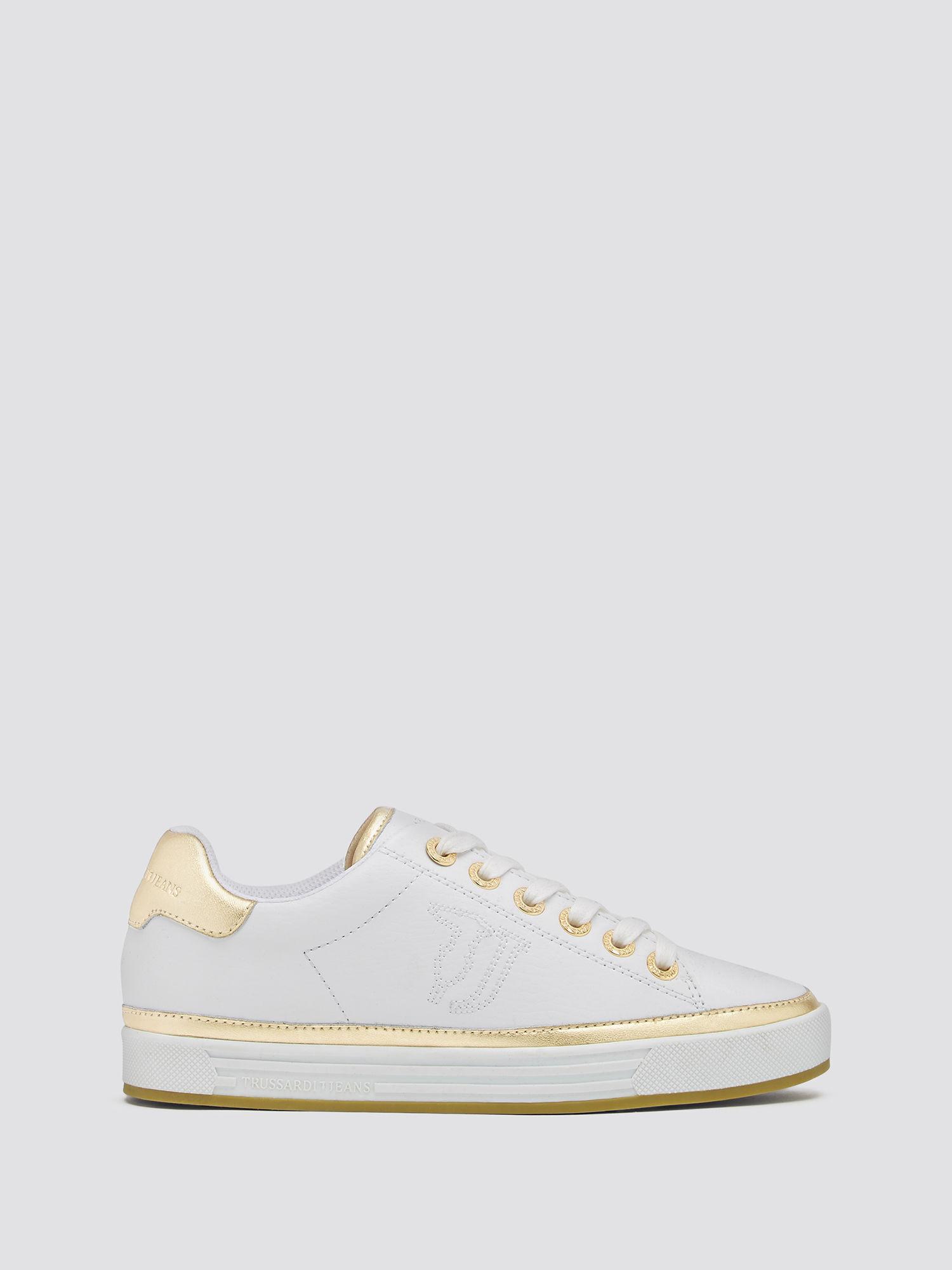 Sneakers a bordures et logo brode