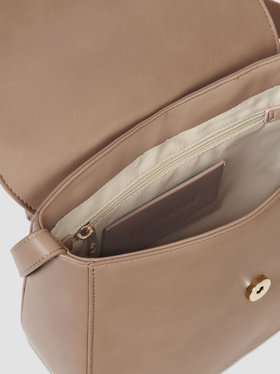 Medium crossbody bag in solid colour faux leather