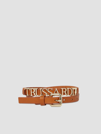 Leather belt with metal lettering