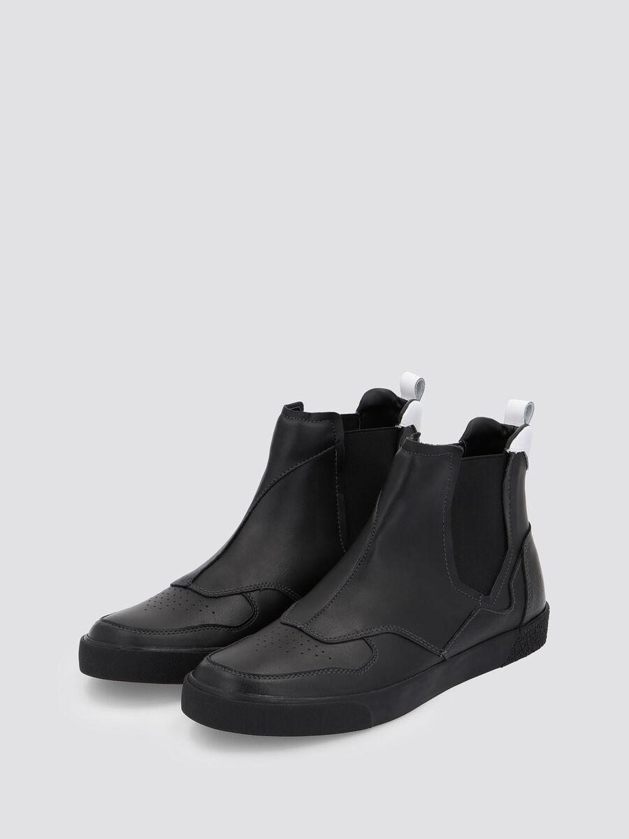 Sneakers in pelle con fascia elastica