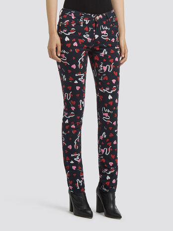 Skinny jeans with heart and belt print