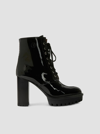 Heeled patent leather combat boots