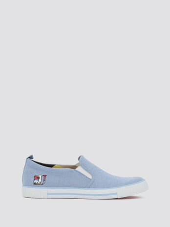 Slip ons with landscape themed logo