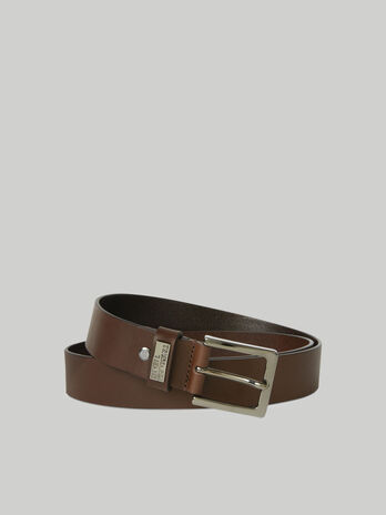 Leather belt with branded metal plate