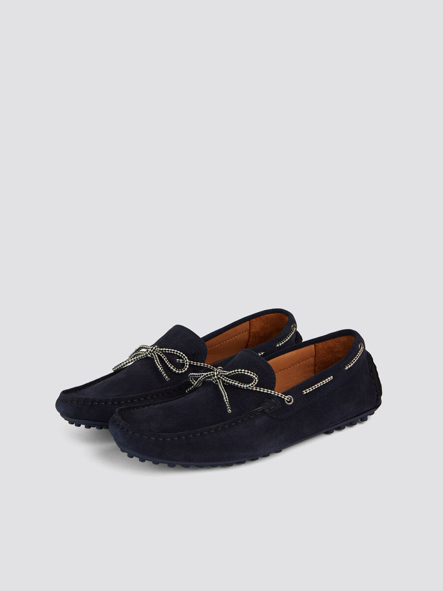 Suede loafers lacing and rubber studs on the sole