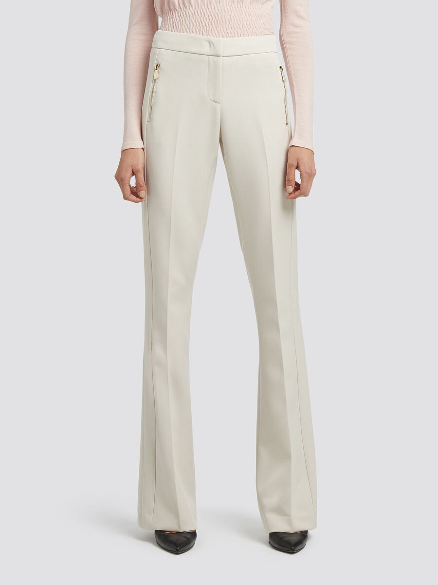 Solid colour stretch flared trousers