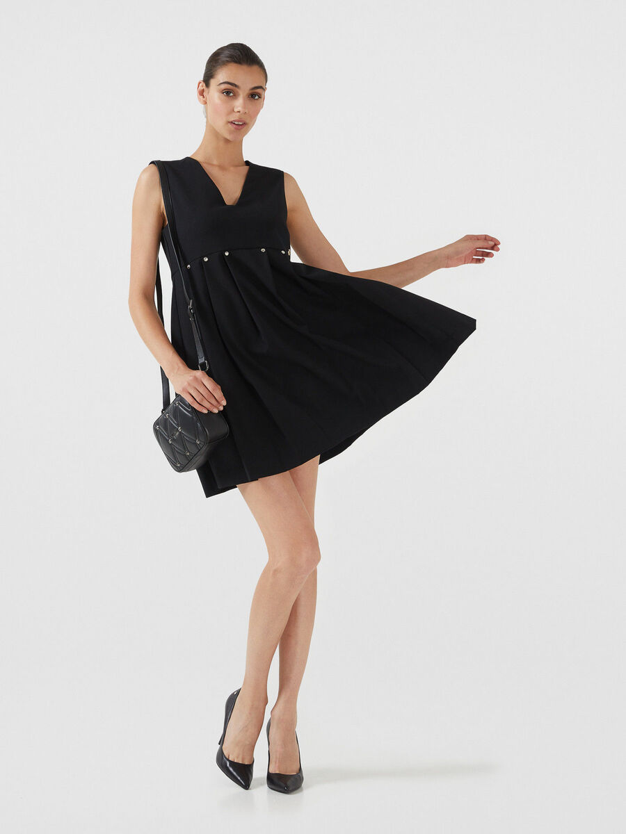 Yarn dyed dress with pleated skirt
