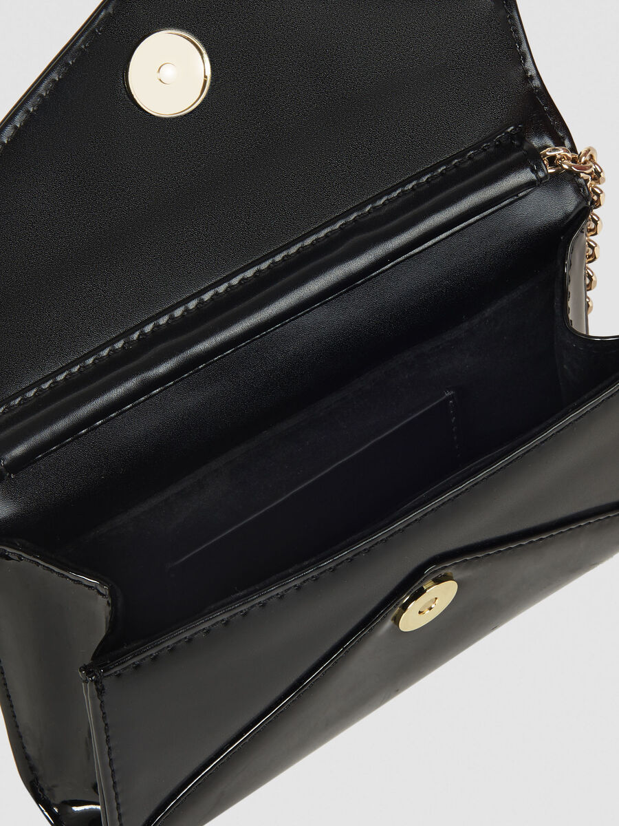 Two tone clutch in faux leather and patent leather