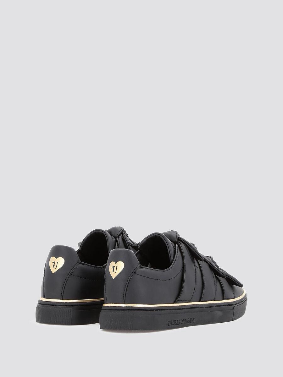 Sneakers con bande a fascia annodate