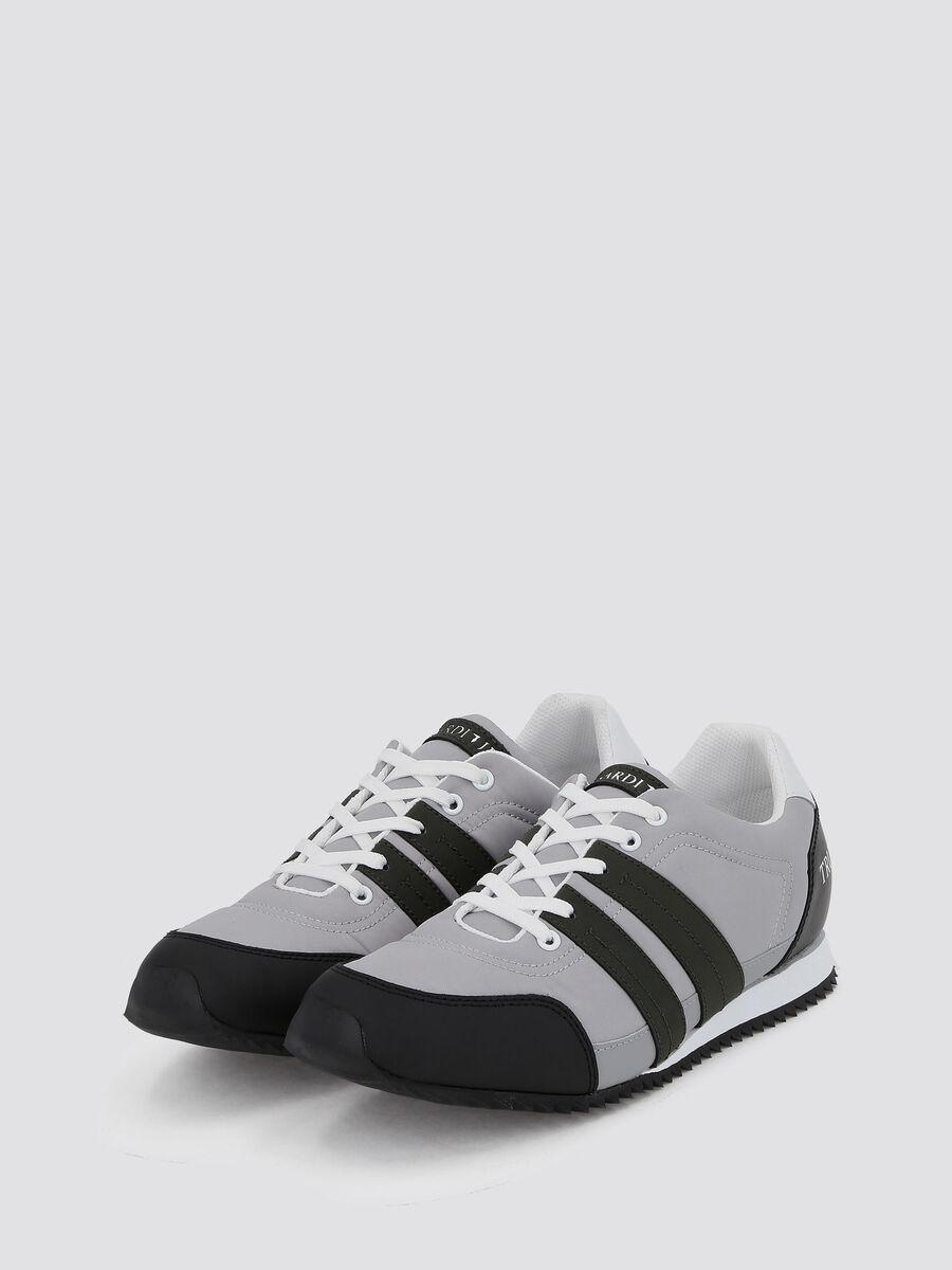 Sneakers running con bande e logo