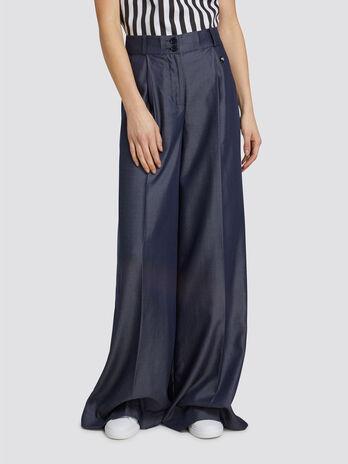 Pantaloni over fit in denim effetto tencel e mini logo