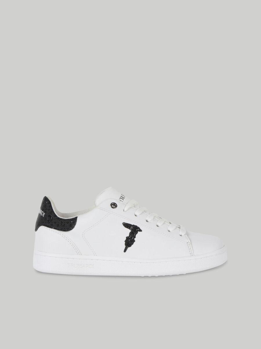 Sneakers en cuir a logo paillete