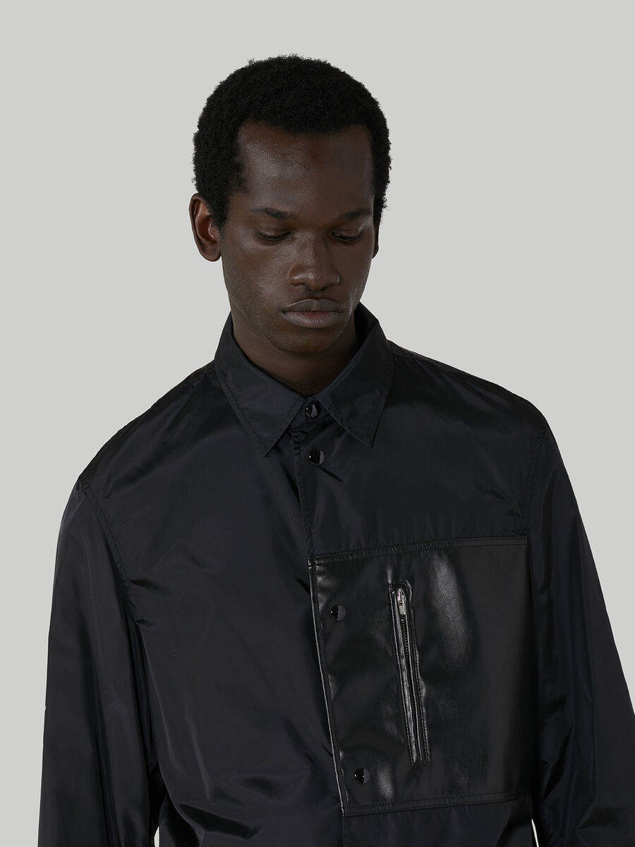 Pardessus en nylon a poche zippee