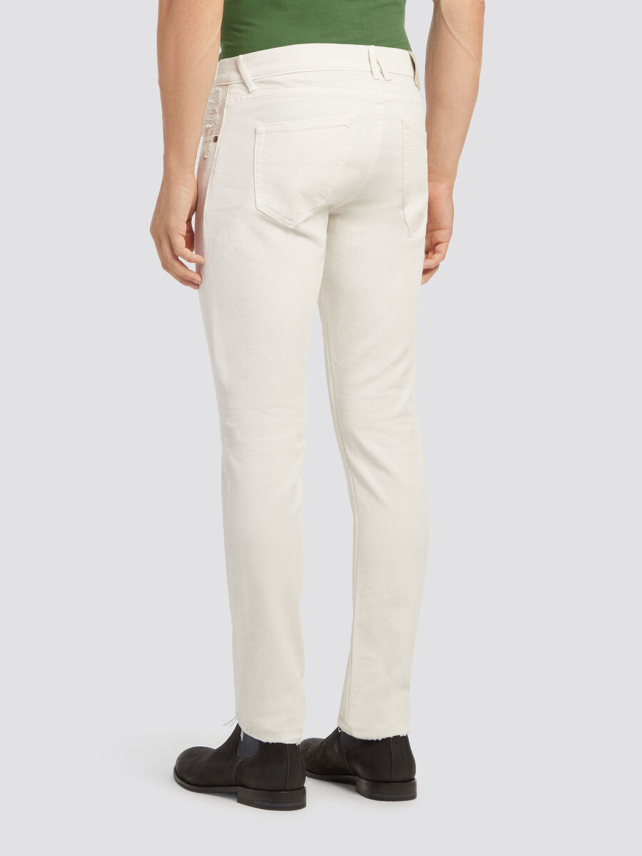 Jean coupe skinny a abrasions